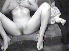 Hawt black-and-white home movie scene with busty dark brown doing a oral-service on her boy-friend's pecker and riding it in reverse position.