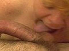 This mature redhead gives a lengthy hawt blowjob. Engulfing and licking cock and working his balls hard until that guy shoots his hawt load of cum.