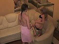 Luxurious hotel room with comfortable sofa turned into a sexy fuck platform for 2 harlot bimbos watched by spy camera. They stripped and enjoyed the wildest rubbing act for their wet beavers!