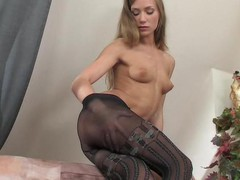 Strict looking office beauty strips to her mock hold-up tights and gets wild