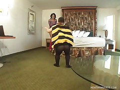 Nikki Vonn is a hot brunette playgirl and she is wearing a sexy pantie with high heels and fishnet dress. Now there is this midget dude in a costume of a hottie bee. And lewd playgirl Nikki doesn't mind to be his flower! See how she is sucking midget bee's stinger of love and taking all the hottie out of it!