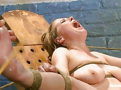 Her moaning and screaming won't help this bitch to much. The executor craves to make her pussy wet even if it means to spank and use water jets on it. She is tied with her sexy legs spread and her pink, shaved vagina is at fully display. Perhaps this sweetheart will squirt if the man keeps it up that way