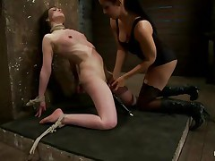 This is hawt and only gets better, a dominating milf wearing stockings and hot clothing is showing a younger gal who's the boss. She ties her with rope and as the rope goes through those her love tunnel lips, a weight at the end of the rope makes things more interesting. The chick is suffocated too and probably she enjoys it a lot!
