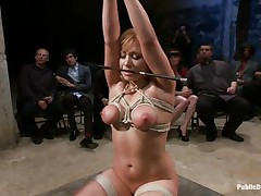 Lea is on her knees, tied up and fucked in the mouth. The public is watching her with attention and surely they will applaud her, that playgirl is giving her best to make the show interesting and that guy inserts his large hard cock deep in her mouth, making her gag a bit. Look at her, will that playgirl receive a large load?