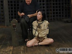 Sexy brunette Elise is all bound up and shackled and sits obedient on the floor near to her executor who puts a mask on her face. This guy explains this s&m technique and what this hottie is supposed to do. The bitch enjoys being the center of attention and waits for her bondage treatment. Wanna see what happens to her?