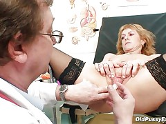Older blonde Nora is a floozy with large boobs and large hairless vagina that is examined by a gynecologist. The doctor uses a metal speculum and gapes her wet crack so we can watch inside it. This floozy seems to be healthy and her wet crack is now willing for a hard fuck.