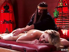 Mia is tensed and that chick needs a nice, oily massage. This hot golden-haired chick stays laid on her back, completely naked as Bill takes care of her superb body. He slides his hands on her ideal ass, massaging it firmly and then rubs her shaved pussy. Mia gets slutty and now wants to fuck!