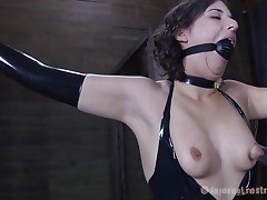 Brunette hair Marina wearing a dark latex suit and having a big dark ball gagging her mouth is about to be punished by her executor. The man starts with her zeppelins and uses very big suckers to castigation 'em and when Marine's nipps are hard this chab ties 'em with rubber bands. Appears to be that babe will stay there for a lengthy time
