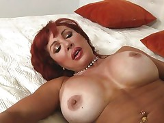 Her years of experience in fucking have a lot to say. Check out this gorgeous redhead milf and how lustfully this babe sucks and bonks cock. Damn the bitch knows how to drink a cock and when this babe goes on top and rides this guy we can clearly see her pussy lips spreading. Yep this milf needs some jizz deep inside her