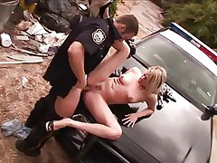 Mr. police officer does his job with rigorous attention. He takes of this blonde short pants and begins licking her sexy haunches and then her juicy vagina, using all his tongue as he does that. The blonde delinquent receives a hard fingering as a treatment and then he takes out his big hard knob and stuffs her muffin with it. This babe can't live out of it and her nice titties, lengthy sexy legs and excited face will surely make him cum.