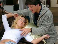 A blond girl visits a second hand furniture shop. After a whilst she...