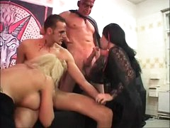 Strange foursome with tattooed and pierced gals