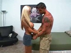 Nikki Benz on her knees engulfing big rod