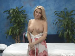 Golden-haired Madison bares her large boobs