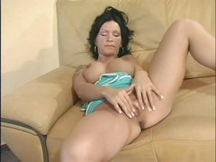 Busty Sabrina Dotee rubs her cleanly shaved pussy